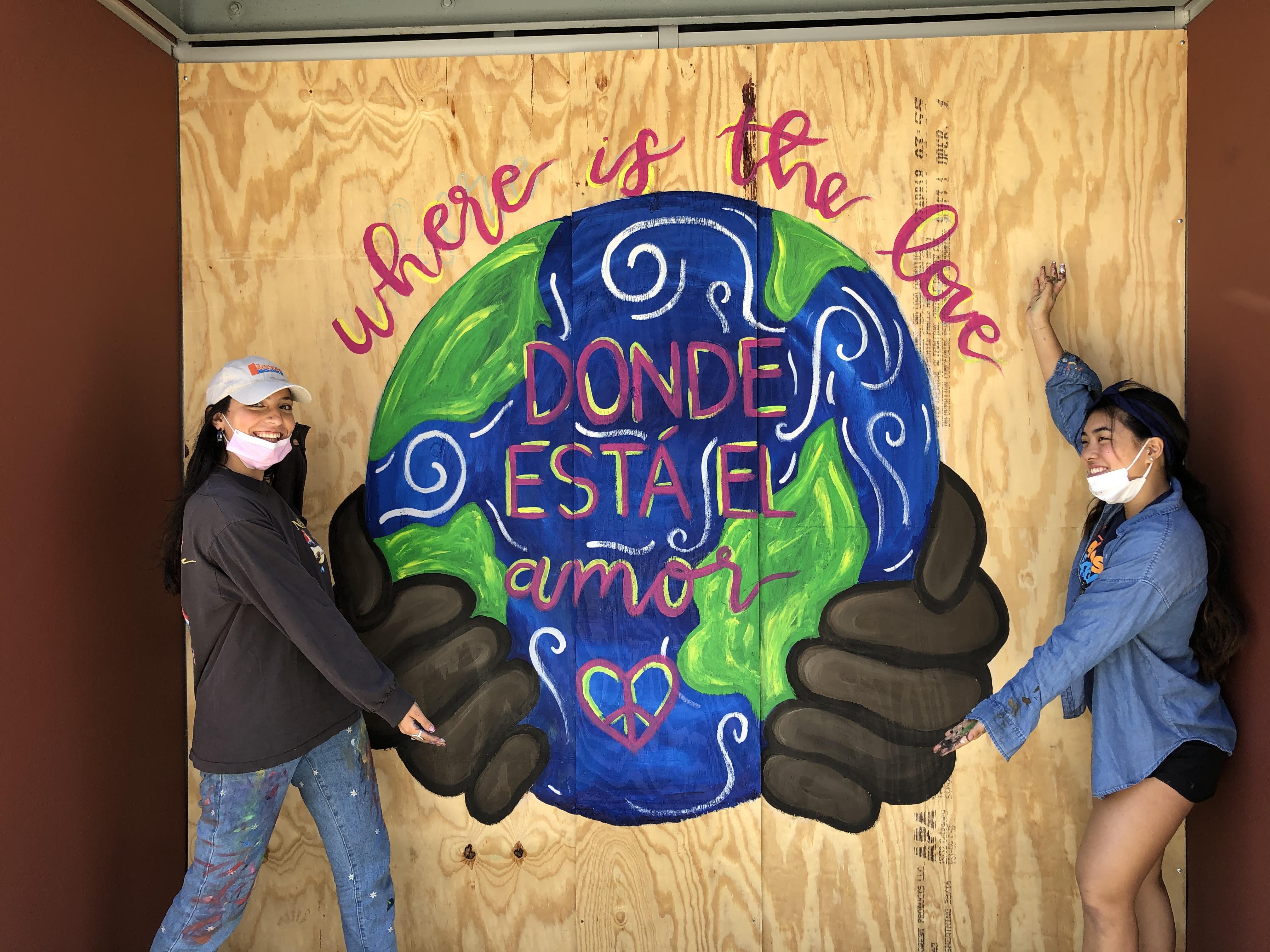 SMHS students Claire F. and Alana I. in front of a mural they created
